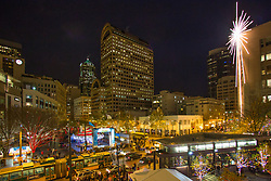 North America, United States, Washington,  Seattle, Giant holiday star and holiday carousel in Westlake Park