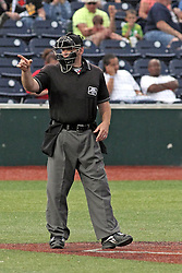 06 July 2013:   Plate umpire Mark Winters calls a strike during a Frontier League Baseball game between the Gateway Grizzlies and the Normal CornBelters at Corn Crib Stadium on the campus of Heartland Community College in Normal Illinois