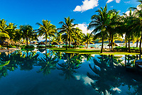 Reflections of palm trees in the swimming pool, Four Seasons Resort Bora Bora, Motu Tehotu, Bora Bora, French Polynesia.