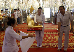 July 26, 2018 - Uthai Thani, Thailand - A Thai devotee carry a Buddhist statue as she visit at Wat Tha Sung ahead of Asanha Bucha Day in Thailand's Uthai Thani province on July 26, 2018. Asanha Bucha Day, the anniversary of Buddha's first sermon, will be celebrated in Thailand on Friday. (Credit Image: © Chaiwat Subprasom/NurPhoto via ZUMA Press)