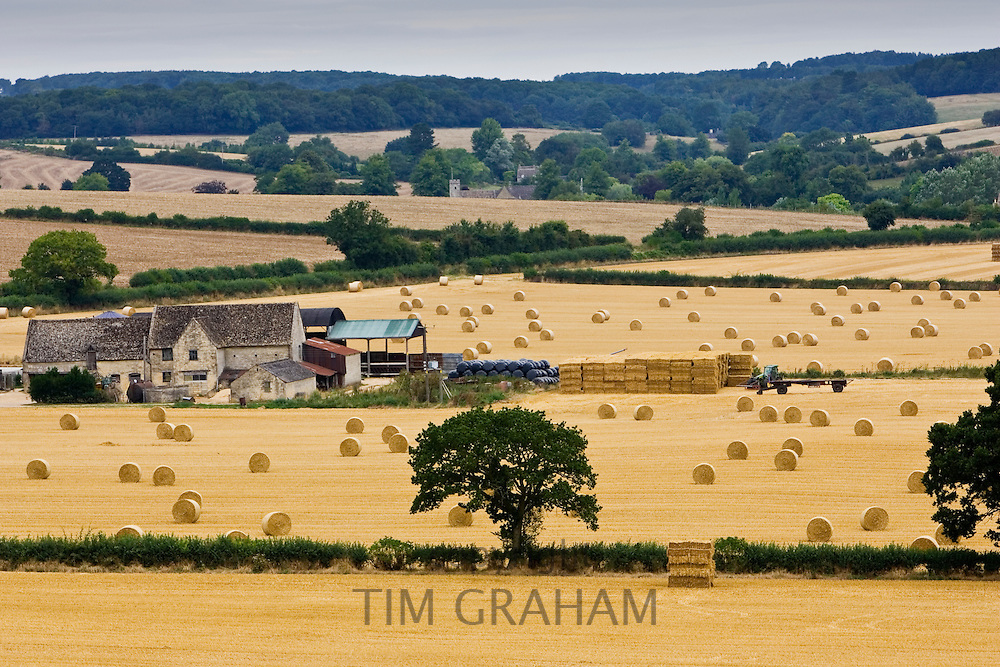 Straw bales and farm in the Cotswolds at Swinbrook in Oxfordshire, United Kingdom