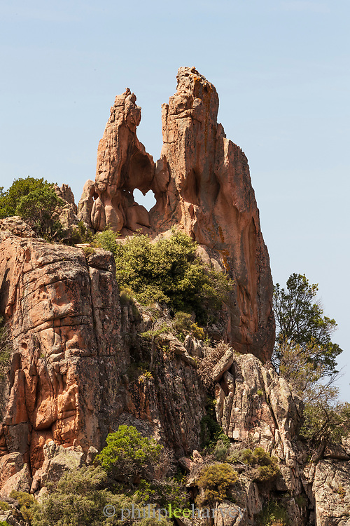 Low angle view of heart shaped rock, Calanches de Piana, Gulf of Porto, Corsica, France