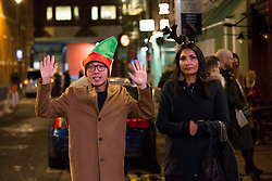 © Licensed to London News Pictures.15/12/2020. London, UK. Londoners making the most of the last night out in Covent Garden, before London will go into Tier 3 tomorrow. Photo credit: Marcin Nowak/LNP