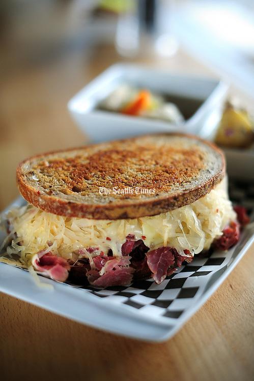 Reuben sandwich with corned beef, Swiss cheese, sauerkraut and Russian dressing on rye bread. <br /> John Lok / The Seattle Times