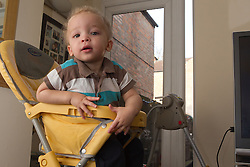 Boy at home in high chair. (This photo has extra clearance covering Homelessness, Mental Health Issues, Bullying, Education and Exclusion, as well as the usual clearance for Fostering & Adoption and general Social Services contexts,)