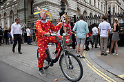 Anti Brexit protester dressed up as a clown version of Prime Minister Boris Johnson hires a Boris bike to Downing Street as it is announced that Boris Johnson has had his request to suspend Parliament approved by the Queen on 28th August 2019 in London, England, United Kingdom. The announcement of a suspension of Parliament for approximately five weeks ahead of Brexit has enraged Remain supporters who suggest this is a sinister plan to stop the debate concerning a potential No Deal.