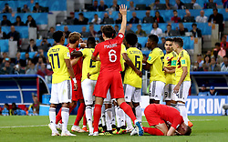 Tempers flare whilst England's Jordan Henderson (bottom right) crouches on the floor after being head butted by Colombia's Wilmar Barrios during the FIFA World Cup 2018, round of 16 match at the Spartak Stadium, Moscow.