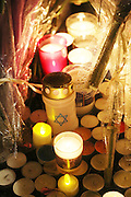 """Candles lit for victims. French and Jews come together to make a vigil outside a Kosher supermarket in Porte Vincennes, Paris, France. Yesterday this Kosher supermarket was the scene of a hostage taking and followed by an armed shoot out between Jihadist gunmen and French police. It ended in a shoot out and with the death of the terrorists. Some hostages were killed and police injured.<br /><br />This event was directly linked to the attack on the offices of Charlie Hebdo, killing twelve people, including the editor and celebrated cartoonists two days before. This week was the deadliest week of terror attacks in France for over fifty years. Charlie Hebdo is a satirical publication well known for its political cartoons. <br /><br />As a solidarity actions with the deaths at Charlie Hebdo many placards read """"Je suis Charlie"""" translating as """"I am Charlie (Hebdo)"""". Demonstrators held aloft pens, brushes and crayons, symbolizing the profession of journalists and cartoonists who were killed."""