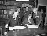 Dissolution of  22nd  Dáil Éireann 1982. .27/01/1982.01/27/82.27th January 1982.Image of President Patrick Hillary and Taoiseach Garret Fitzgerald preparing to sign the warrant of dissolution of the Dáil. The signing was carried out at  Áras an Uachtaráin
