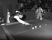 """The Benson and Hedges .Irish Masters Snooker..1984..28.03.1984..03.28.1984..28th March 1984..The championship was held at Goffs,Co Kildare. All the top names in snooker took part..Steve Davis,Jimmy White,Eddie Charlton,.Tony Knowles,Dennis Taylor,Tony Meo,.Alex Higgins,Ray Reardon,.Cliff Thorburn,Terry Griffiths,.Bill Werbeniuk and Eugene Hughes..The eventual winner was Steve Davis who beat Terry Griffiths 9 -1 in the final..Image as Jimmy White """"breaks"""" to get the second frame underway, as Tony Meo gets a drink."""