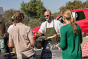 Participants help themselves to avant-garde cuisine during Cook it Raw outdoor BBQ event on Bowen's Island October 26, 2013 in Charleston, SC.