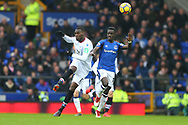 Christian Benteke of Crystal Palace (l) passes the ball while under pressure from Idrissa Gueye of Everton. Premier league match, Everton v Crystal Palace at Goodison Park in Liverpool, Merseyside on Saturday 10th February 2018. pic by Chris Stading, Andrew Orchard sports photography.