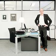 Nederland, Groningen, 20081125..Jaap Engbers staande in zijn werkruimte. Lid van het College van Bestuur van de Onderwijsgroep Noord .