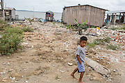 2016/10/05 - Muisne, Ecuador: A boy passes in front of place where before many families lived on the coast of Chamanga, Ecuador, 5th October 2016. The Ecuadorian Government doesn't want to rebuild houses on the coast of Chamanga since it is consider a high-risk area, something that the locals deny. The earthquake reached the magnitude of 7.8 on the Richter scale hit the Ecuadorian coast, where more than a million and half of people live, circa 10% of the total population of the country. On the aftermath, 4,859 were injured and 671 died, mostly because of the collapse of buildings. The areas affected are in a vulnerable socio-economic position, with levels of extreme poverty in some cases, which contributed to the high number of injured and perish people. (Eduardo Leal)