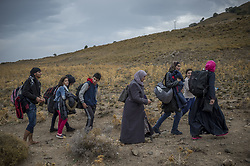 Oct. 11, 2015 - Lesbos Island, Greece - Refugees and Migrants arrive on the Greek Island of Lesbos after crossing the Aegean sea from Turkey on October 11, 2015  (Credit Image: © Antonio Masiello/NurPhoto via ZUMA Press)