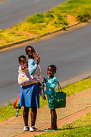 Family walking along street in Soweto (South Western Townships), Johannesburg, South Africa.