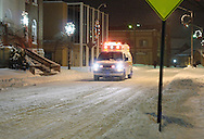 Middletown, NY - An ambulance drives down a snow-covered street during a winter storm on Dec. 19, 2008.