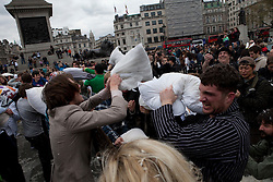 © Licensed to London News Pictures. 07/04/2012. London, U.K..Pillow fight day 2012, Trafalgar Square, central London, today 7th April 2012. On Saturday April 7th 2012, there will be massive pillow fights in cities around the world which is organised by the urban playground movement, a playful part of the larger public space movement..Photo credit : Rich Bowen/LNP