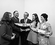"B.I.M.National Seafood Cook..1972..05.05.1972..05.05.1972..5th May 1972..The final of the ""National Seafood Cook 1972"" was held in the Great Southern Hotel,Killarney,Co Kerry.The winner was Miss Mary Coleman (14 years)from the Vocational School, Claremorris,Co Mayo.The title of the winning dish was ""Amber Ring. She was chosen from 18 regional finalists...Picture of Maria Geoghegan ((3rd),Mr Jackie Fahy TD,(left),Parliamentary Secretary to the Minister for Agriculture, presenting the Perpetual Challenge Trophy and a cheque fur £150 to the winner Ms Mary Coleman,Claremorris,Co Mayo, Celine O'Reilly(2nd) and Mr T F Geoghegan,Market Development manager,Bord Iascaigh Mhara (B.I.M.)Centre."