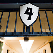 A sign identifies a prison corridor with the number 4 at the Police and Penitentiary Museum that forms one part of the Maritime Museum of Ushuaia. The museum is housed in the city's old prison.