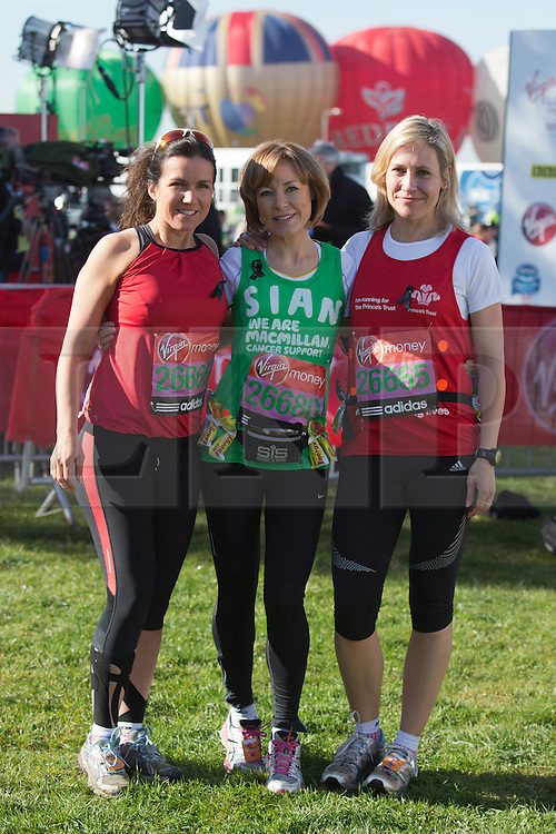 © Licensed to London News Pictures. 21/04/2013. London, England. L-R: BBC presenters Susanna Reid, Sian Williams and Sophie Raworth. Celebrity Runners at a photocall before the start of the Virgin London Marathon 2013 race. Many wore black ribbons to pay their respect for those who died or were injured in the Boston Marathon. Photo credit: Bettina Strenske/LNP
