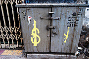 Egypt, Cairo 2014. Qasr el-Nil street grafitti - painting of dollar sign and gun.