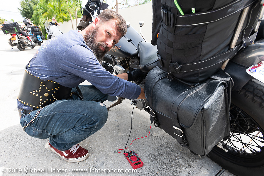 Shane Masters checking electrics on his Class III 1948 Indian Chief during the Cross Country Chase motorcycle endurance run from Sault Sainte Marie, MI to Key West, FL. (for vintage bikes from 1930-1948). Stage-9 covered 259 miles from Lakeland, FL to Miami, FL USA. Saturday, September 14, 2019. Photography ©2019 Michael Lichter.