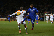 Junior Hoilett of Cardiff city ® challenges Fiyako Tomori  of Hull city. EFL Skybet championship match, Cardiff city v Hull city at the Cardiff city stadium in Cardiff, South Wales on Saturday 16th December 2017.<br /> pic by Andrew Orchard, Andrew Orchard sports photography.