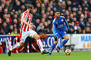 Riyad Mahrez of Leicester City (r) looks to get away from Erik Pieters of Stoke City. Premier league match, Stoke City v Leicester City at the Bet365 Stadium in Stoke on Trent, Staffs on Saturday 4th November 2017.<br /> pic by Chris Stading, Andrew Orchard sports photography.