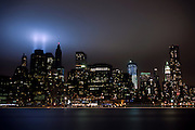 The Tribute of Light is illuminating the cloudy sky over Manhattan, New York, USA, on the 10th anniversary of the 9/11 attacks on the Word Trade Centre.