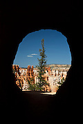 View through a tunnel on the Peekaboo Loop Trail, in Bryce Canyon National Park, Utah.