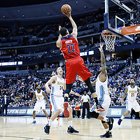 08 March 2017: Washington Wizards forward Otto Porter Jr. (22) takes a jump shot o er Denver Nuggets guard Jameer Nelson (1) and Denver Nuggets center Mason Plumlee (24) during the Washington Wizards 123-113 victory over the Denver Nuggets, at the Pepsi Center, Denver, Colorado, USA.