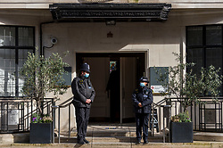 """© Licensed to London News Pictures. 23/02/2021. LONDON, UK. Police stand guard outside the King Edward VII hospital in Marylebone where The Duke of Edinburgh is staying after feeling """"unwell"""" eight days ago.  Photo credit: Stephen Chung/LNP"""