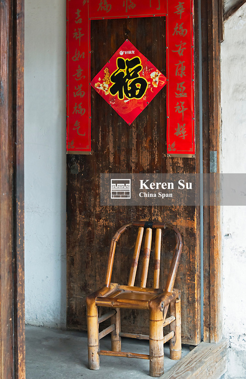Chair with door of traditional house in the water town, Shaoxing, Zhejiang Province, China
