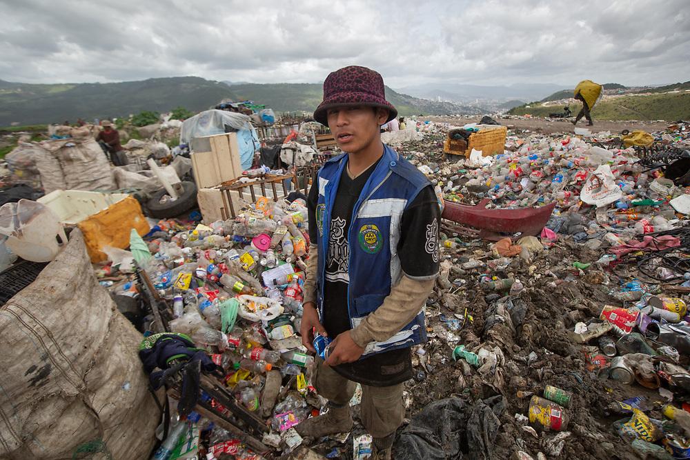 "Norman Alexander Martínez López, 17, alias ""Jesús"", from the El Guanábano neighbourhood of Tegucigalpa. He makes 80 Lempiras a day recycling tins and plastic bottles on the Tegucigalpa municipal dump."