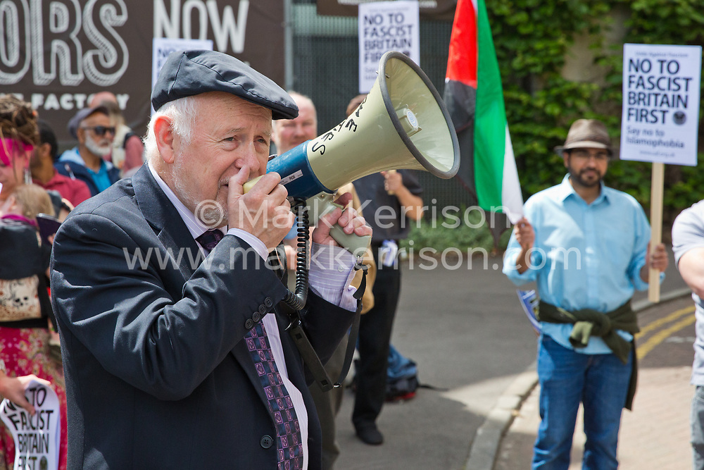 Luton, UK. 27th June, 2015. Kelvin Hopkins, Labour MP for Luton North, addresses local residents and anti-racist activists from Unite Against Fascism at a counter-protest against a march by far-right group Britain First. A large police presence kept the two groups apart.