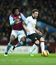 Aston Villa's Carlos Sanchez battles for the ball with Manchester United's Juan Mata  - Photo mandatory by-line: Joe Meredith/JMP - Mobile: 07966 386802 - 20/12/2014 - SPORT - football - Birmingham - Villa Park - Aston Villa v Manchester United - Barclays Premier League