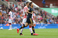 Son Heung-Min of Tottenham Hotspur celebrates after scoring his teams 1st goal. Premier league match, Stoke City v Tottenham Hotspur at the Bet365 Stadium in Stoke on Trent, Staffs on Saturday 10th September 2016.<br /> pic by Chris Stading, Andrew Orchard sports photography.