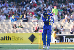 © Licensed to London News Pictures. 08/03/2012. Adelaide Oval, Australia. Tillakaratne Dilshan misjudges & gets a top edge resulting in him being caught for 8 runs during the One Day International cricket match final between Australia Vs Sri Lanka. Photo credit : Asanka Brendon Ratnayake/LNP