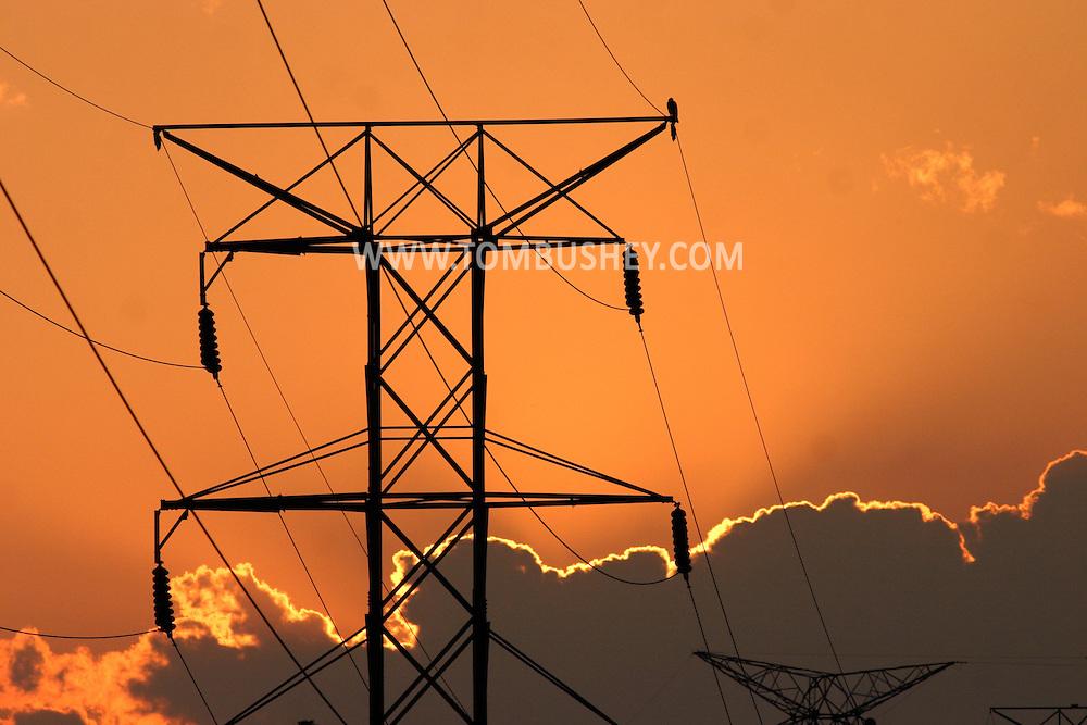 Wawayanda, N.Y. - The setting sun illuminates clouds behind power lines in the Town of Wawayanda, N.Y., on May 29, 2006. ©Tom Bushey
