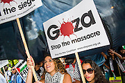 """As the march passes the US embassy passions increase. Stop the 'massacre' in Gaza protest. A demonstration called by the Palestine Solidarity Campaign (PSC). They assembled at the BBC offices in Regent Street and marched to The US Embassy and on to a rally in Hyde Park. They called for """"Israel's bombing and killing to stop now and for David Cameron to stop supporting Israeli war crimes"""". London, 09 Aug 2014."""
