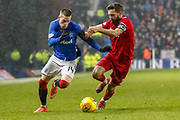 Ryan Kent of Rangers & Graeme Shinnie of Aberdeen FC battle for the ball during the William Hill Scottish Cup quarter final replay match between Rangers and Aberdeen at Ibrox, Glasgow, Scotland on 12 March 2019.