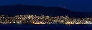 Panorama of the City of North Vancouver at night from Stanley Park in British Columbia, Canada