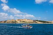 Tourist boat passing Manoel Island, Malta