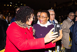 """London, October 23 2017. Nelson Mandela's group of Elders including former UN Secretary General Kofi Annan and Secretary General Ban Ki-moon accompanied by his widow Graca Machel gather at Parliament Square at the start of the Walk Together event in memory of Nelson Mandela before a candlelight vigil at his statue in Parliament Square. """"WalkTogether is a global campaign to inspire hope and compassion, celebrating communities working for the freedoms that unite us"""". PICTURED: A woman asks for a selfie with Graca Machel. © Paul Davey"""