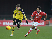 Fleetwood Town's Liam Mcslinfrn vies for possession with Bristol City's Korey Smith<br /> <br /> Photographer Ashley Crowden/CameraSport<br /> <br /> Football - The Football League Sky Bet League One - Bristol City v Fleetwood Town - Sunday 1st February 2015 - Ashton Gate - Bristol<br /> <br /> © CameraSport - 43 Linden Ave. Countesthorpe. Leicester. England. LE8 5PG - Tel: +44 (0) 116 277 4147 - admin@camerasport.com - www.camerasport.com