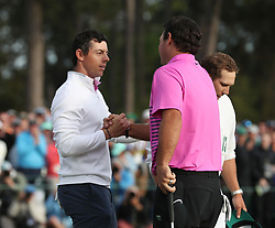 April 8, 2018 - Augusta, GA, USA - Rory Mcllroy, left, congratulates Patrick Reed after the final round of the Masters at Augusta National Golf Club on Sunday, April 8, 2018, in Augusta, Ga. (Credit Image: © Jason Getz/TNS via ZUMA Wire)
