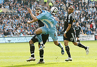 Photo: Steve Bond/Richard Lane Photography.<br />Coventry City v Chelsea. FA Cup 6th Round. 07/03/2009. Leon Best (C) takes on Alex (obscured L) and Jose Bosingwa (R)