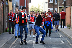 23rd August 2017 - UEFA Champions League - Play-Off (2nd Leg) - Liverpool v 1899 Hoffenheim - Liverpool fans enjoy a beer as they walk to the game - Photo: Simon Stacpoole / Offside.