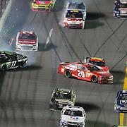 NASCAR Sprint Cup drivers Matt Kenseth (20) and Denny Hamlin (11) wrecks during the NASCAR Coke Zero 400 Sprint series auto race at the Daytona International Speedway on Saturday, July 6, 2013 in Daytona Beach, Florida.  (AP Photo/Alex Menendez)